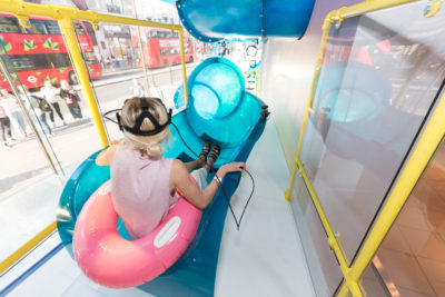 Woman in a slide with VR glasses; copyright: Topshop