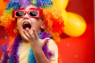 Child in colourful costume is happy