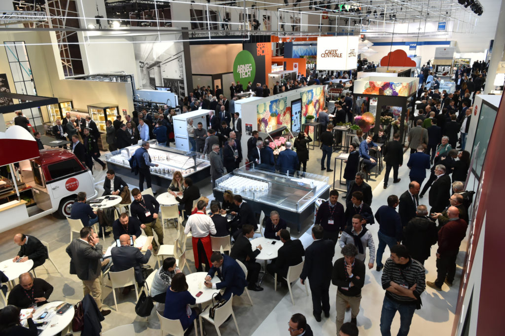 An exhibition hall full of people and stands