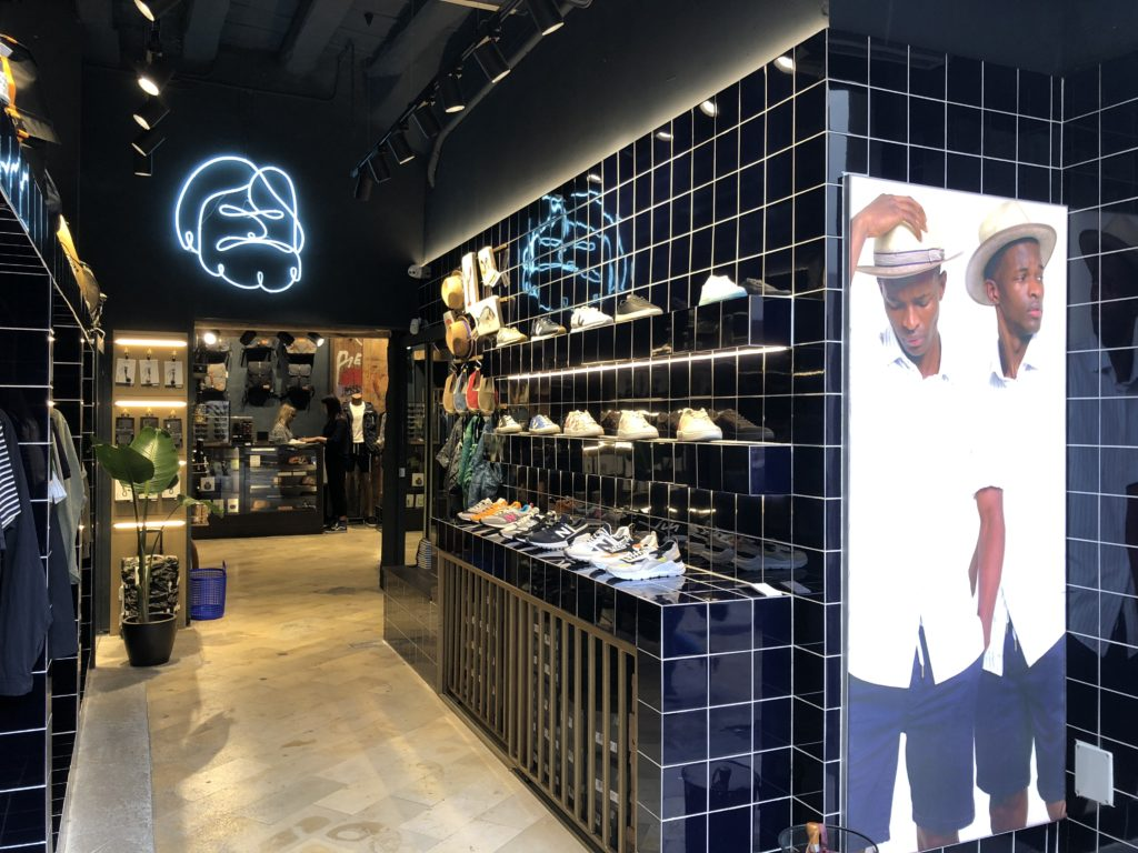 Picture from a fashion store for men in Barcelona with blue tiles