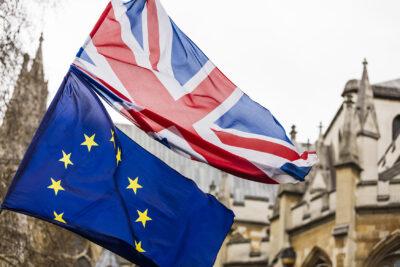 waving english and european flag