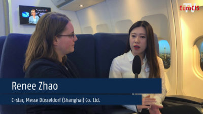 Interviewer with Interviewee Mrs. Zhao from C-star in a fake airplane; copyright: beta-web