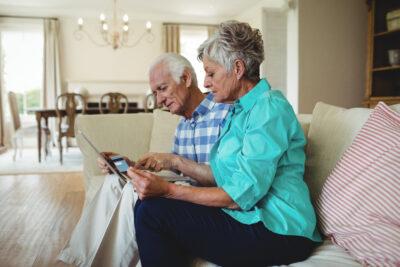 Senior couple doing online shopping on laptop at home