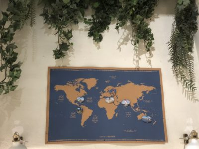 A map of the world hangs on the wall