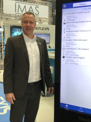 Man stands in front of large display at the EuroShop 2020; copyright: beta-web GmbH