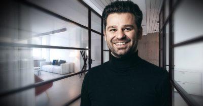 A man in black sweater