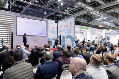 Visitors in the audience at an event at a trade fair