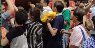 Chinese customers crowding together in a store