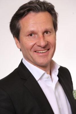 Smiling man with dark hair