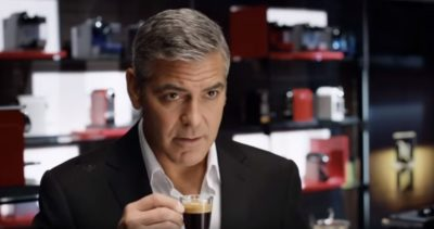 Actor Goerge Clooney drinks a cup of espresso; screenshot from YouTube video
