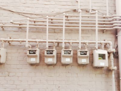 Several electricity meters on one wall