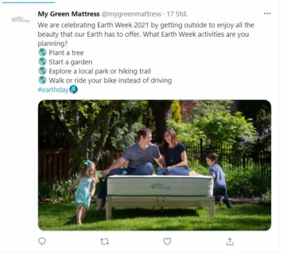 Twitter post from My Green Mattress for Earth Day with a picture of a family in the garden on a bed, text suggests taking a walk or bike ride or planting a tree