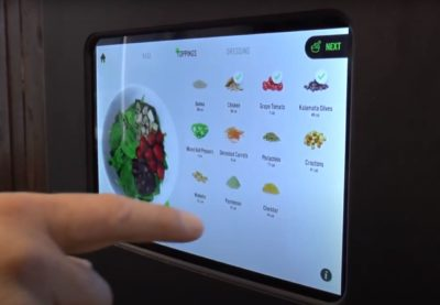 A finger that selects ingredients on a screen