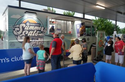 Customers line up at an open food truck
