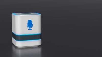 A smart voice wizard, small white device with blue microphone icon
