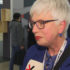 Woman with grey hair and glasses gives interview; copyright: beta-web GmbH