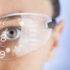 Mann mit durchsichtiger Brille sieht virtuelle Zahlen; copyright: panthermedia.net / dragonstock