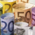 Rolled euro banknotes; copyright: PantherMedia / moodboard