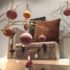 Velvety Christmas tree balls on a branch in front of a velvety brown suitcase; copyright: iXtenso/Pott