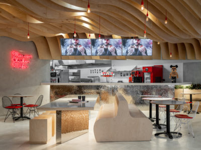 A modern fast food restaurant with wavy wood panels at the ceiling