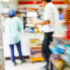 Blurred visual of the inside of a convenience store with customers; copyright: panthermedia.net/smuayc