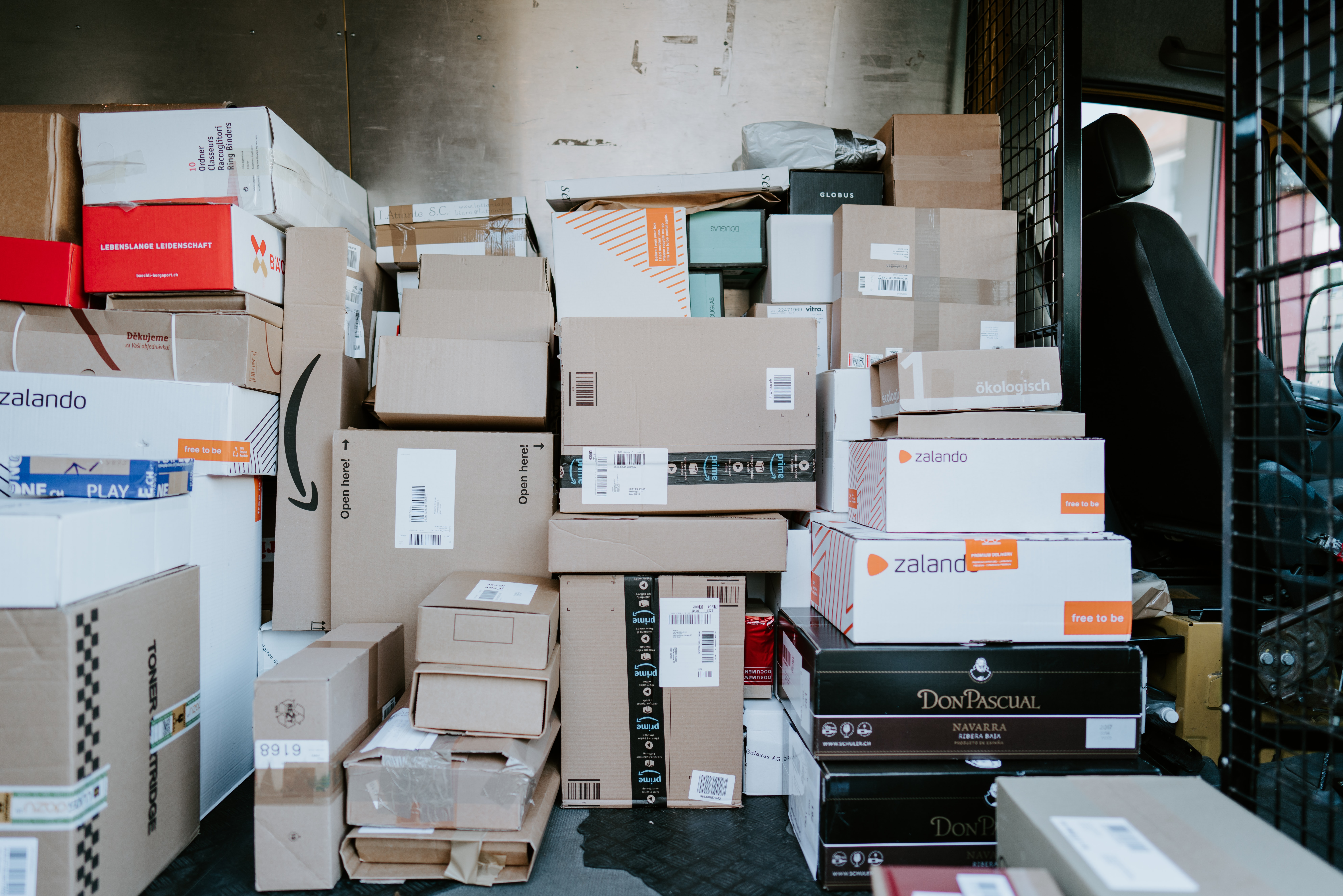 stack of parcels in a delivery van