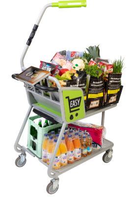 Ein voller Einkaufswagen mit einer senkrechten Stange und einem Tablet-Display am Griff
