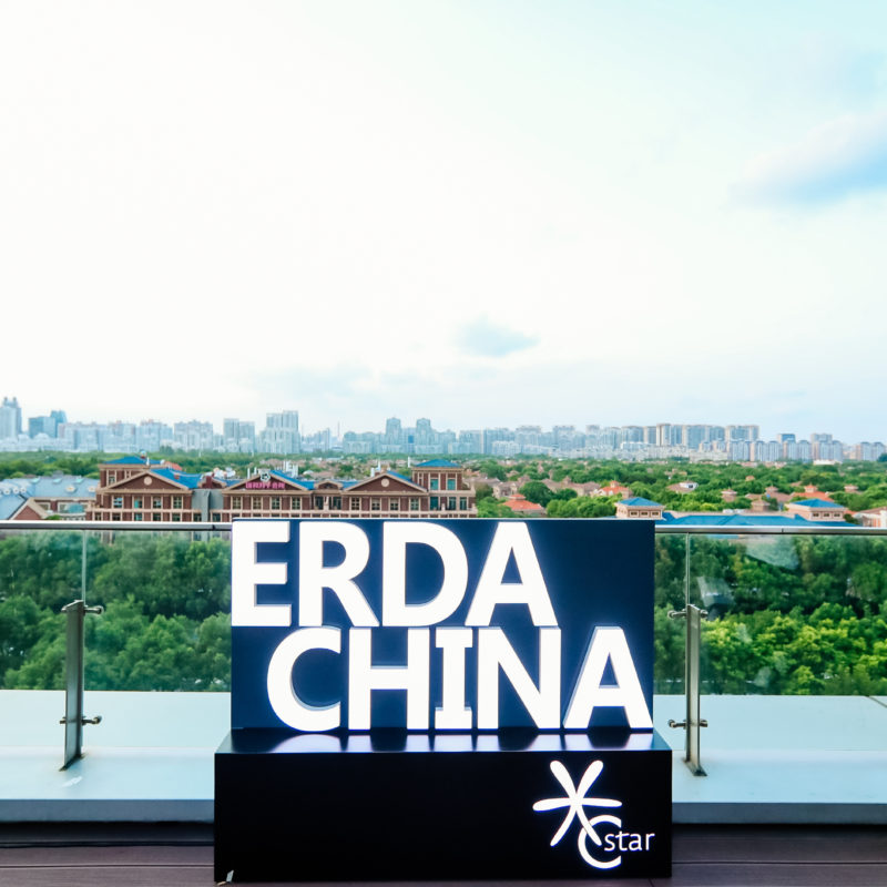A large lettering ERDA China stands before the skyline of Shanghai