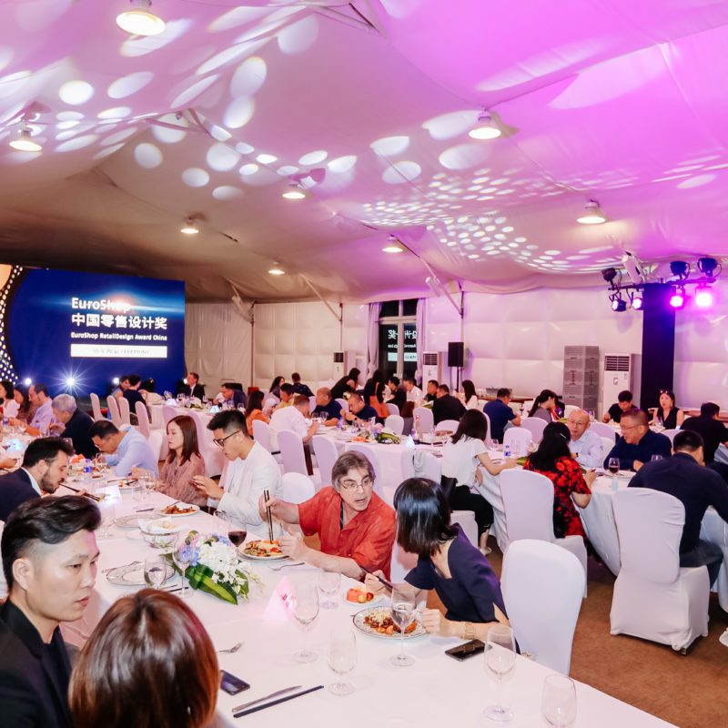 An event hall in Shanghai with many guests at tables