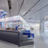 The inside of a modern shopping mall with a bar and sitting accommodations; copyright: Xia Zhi