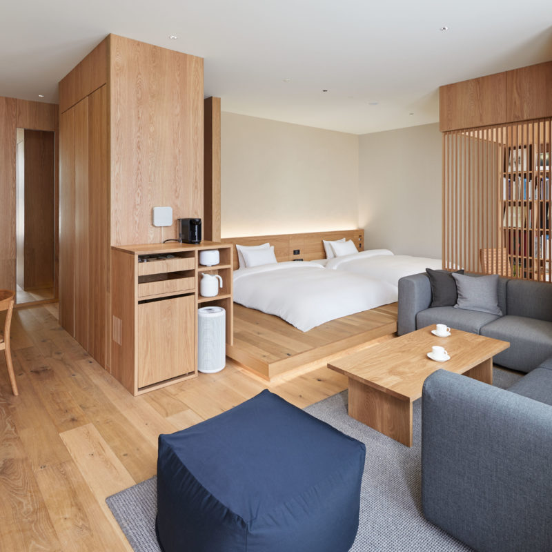 A modern hotel room, simply designed