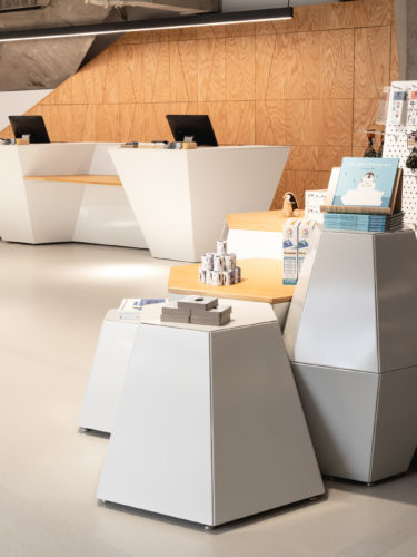 A big store with white hexagonal shop furniture