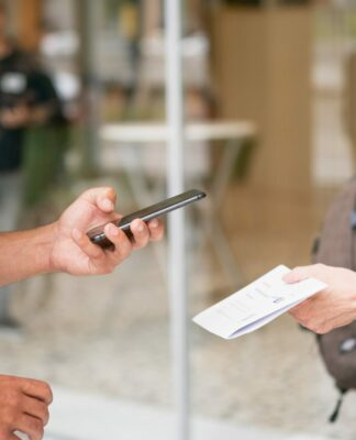 Someone scans a QR-Code on a piece of paper with his smartphone