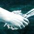 A human hand shaking a robot's hand