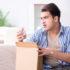 Mann schaut unzufrieden in ein Paket; copyright: panthermedia.net/Elnur_
