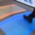 Bild: Fuß wird auf VR-Matte gesetzt; Copyright: iXtenso