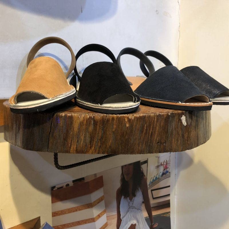 Sandals on a round wooden shelf