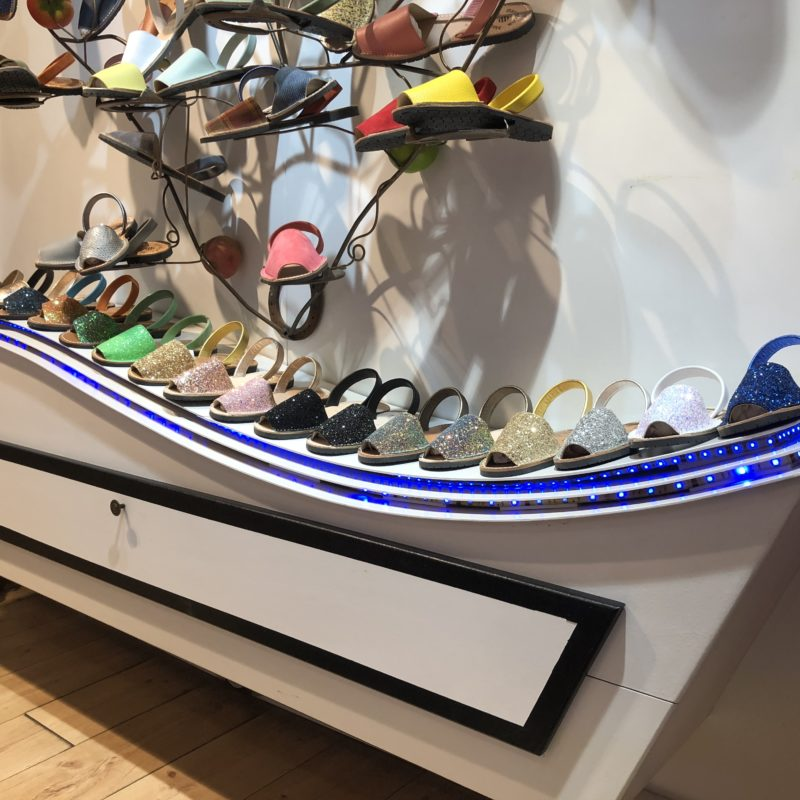 A sideboard with shoes
