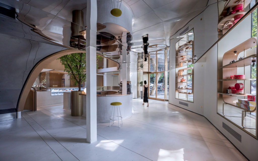 A modern style pastry store with curved arches and large windows