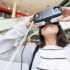 Woman looks through VR glasses; copyright: PantherMedia / Leung Cho Pan