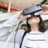 Frau schaut durch VR-Brille; copyright: PantherMedia / Leung Cho Pan