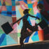 A woman with shopping bags is dancing in front of a colorfully painted wall