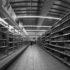 Black and white photo of a supermarket shelf; copyright: Ellinuur Bakarudin