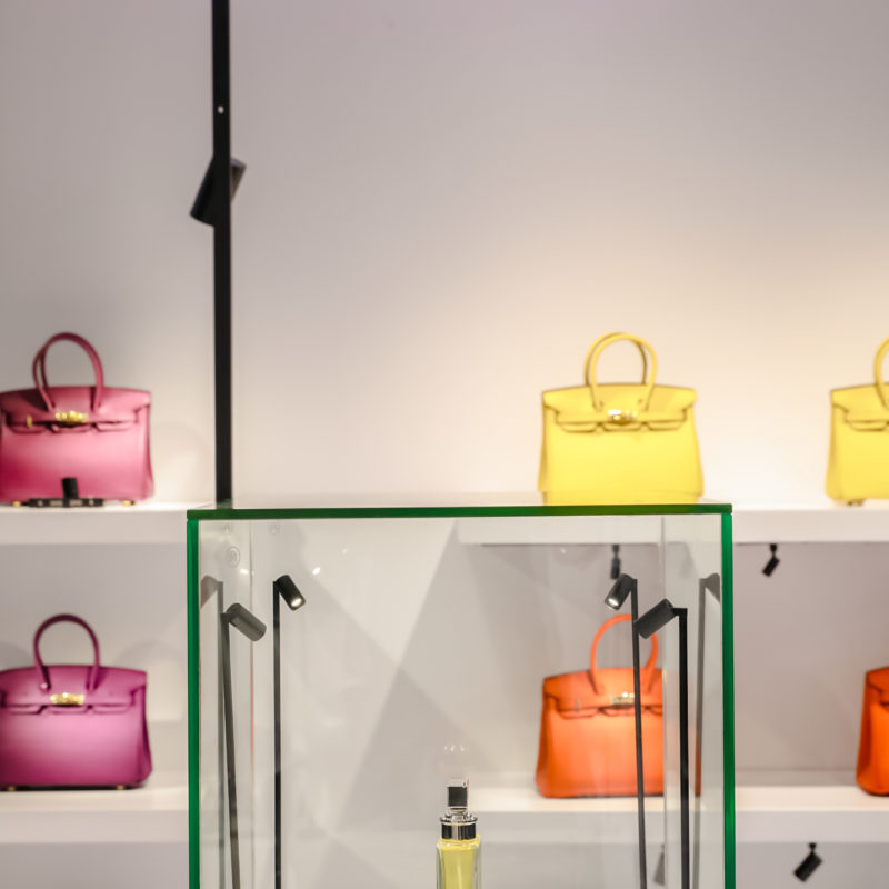 Colorful handbags on shelves