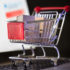 A small shopping cart with mini-packages standing on the keypad of a laptop; copyright: Bildagentur PantherMedia/Andriy Popov