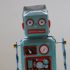 A small blue toy robot; copyright: Rock'n Roll Monkey/Unsplash