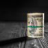 Money isolated on a wooden background; copyright: PantherMedia / Ivantsov