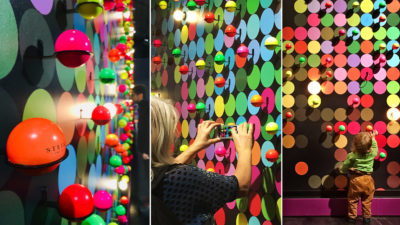 Many colored small balls at a wall
