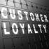 A sign with Customer Loyalty written in large letters