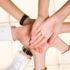 Hände im Kreis übereinander; copyright: PantherMedia / Dmitriy Shironosov